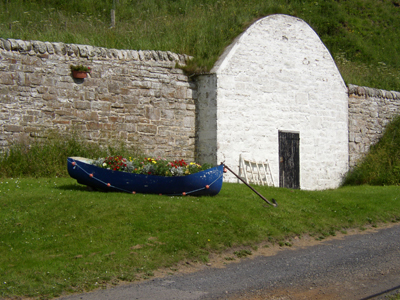 The 'Old Salmon Ice House' and 'Salmon Boat' at Dunbeath Harbour.